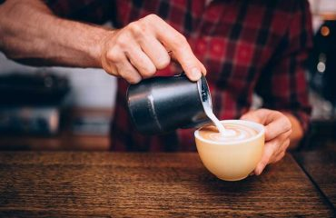 Pouring milk onto an espresso
