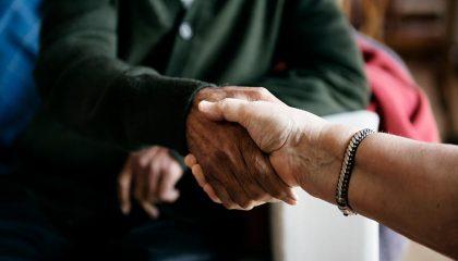 Senior Citizens shaking hands.