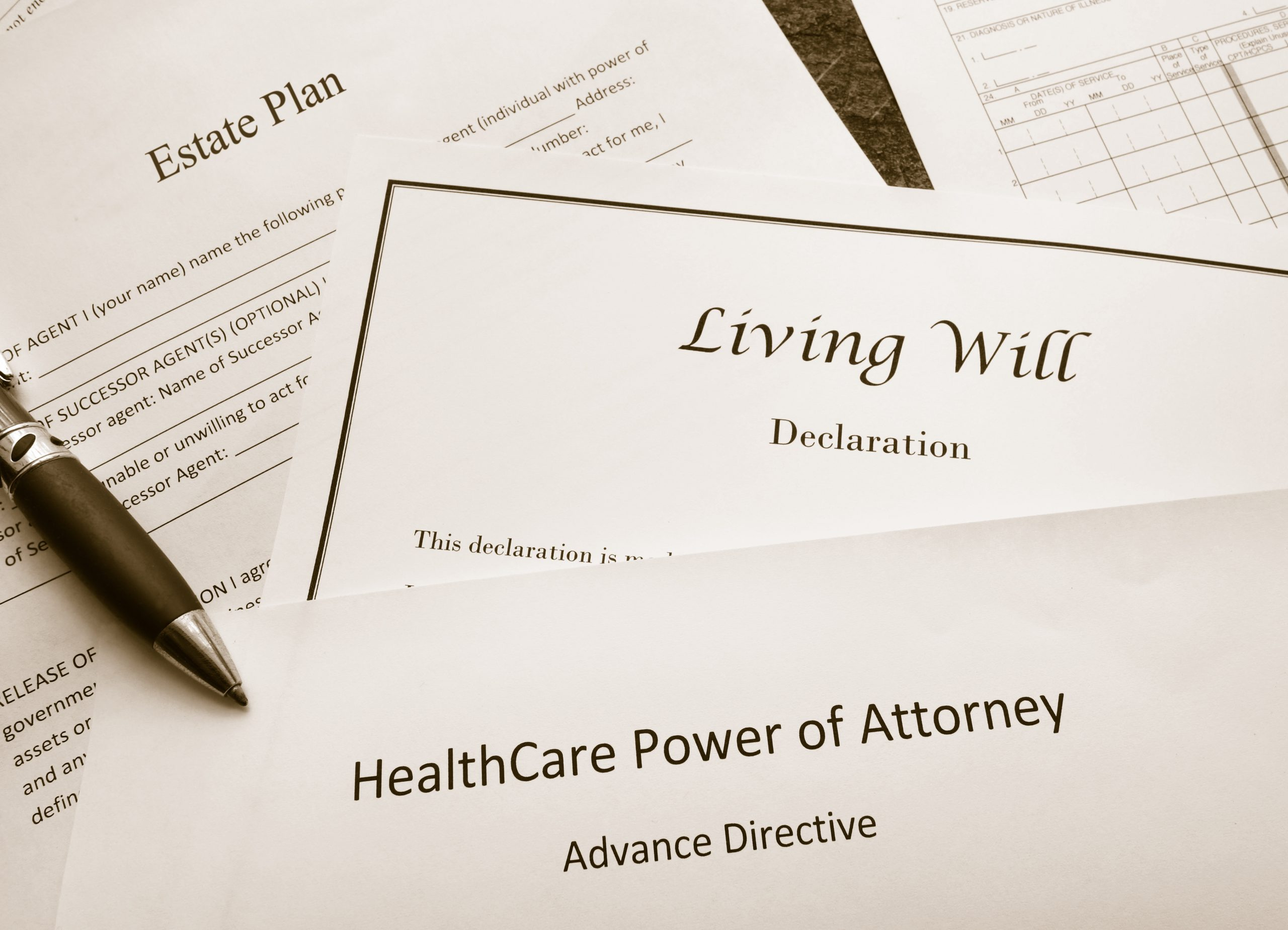 Essential Estate Planning Documents with pen