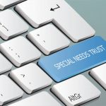 special-needs-trust spelled out on keyboard key